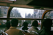 People sitting inside boat trip tour of the city centre Amsterdam, Netherlands 1973