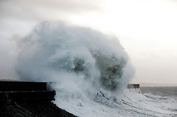 © Licensed to London News Pictures. 13/11/2015. Porthcawl, Bridgend, Wales, UK. Waves crash against the harbour wall at Porthcawl. The South coast of Wales is battered by gale force winds of Storm Abigail, the first storm to be given a name by the Met Office. Photo credit: Graham M. Lawrence/LNP