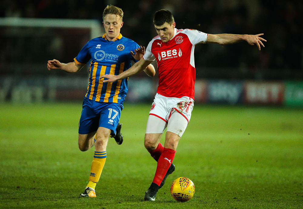 Fleetwood Town's Bobby Grant shields the ball from Shrewsbury Town's Luke Hendrie<br /> <br /> Photographer Alex Dodd/CameraSport<br /> <br /> The EFL Sky Bet League One - Fleetwood Town v Shrewsbury Town - Tuesday 13th February 2018 - Highbury Stadium - Fleetwood<br /> <br /> World Copyright © 2018 CameraSport. All rights reserved. 43 Linden Ave. Countesthorpe. Leicester. England. LE8 5PG - Tel: +44 (0) 116 277 4147 - admin@camerasport.com - www.camerasport.com