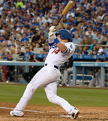 June 24, 2017 - Los Angeles, California, U.S. - Los Angeles Dodgers' Enrique Hernandez RBI single as teammate Logan Forsythe (not pictured) scores against the Colorado Rockies in the second inning of a Major League baseball game  t Dodger Stadium on Saturday, June 24, 2017 in Los Angeles. Los Angeles. (Photo by Keith Birmingham, Pasadena Star-News/SCNG) (Credit Image: © San Gabriel Valley Tribune via ZUMA Wire)