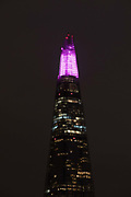 The top spire of the Shard is illuminated in purple, on December 4th 2017 in London, United Kingdom, on the first evening of the Shards festive Christmas light show. Every evening, counting down to the start of 2018, the Shard will illuminate the London skyline from dusk till dawn, with Western Europe's highest light show each evening during December.
