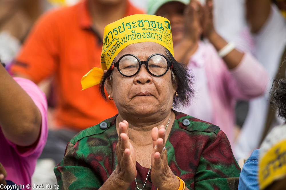04 AUGUST 2013 - BANGKOK, THAILAND: A woman applauds anti-government speakers during a pro-monarchy/anti-government rally in Bangkok. About 2,000 people, members of the  People's Army against Thaksin Regime, a new anti-government group, protested in Lumpini Park in central Bangkok. The protest was peaceful but more militant protests are expected later in the week when the Parliament is expected to debate an amnesty bill which could allow Thaksin Shinawatra, the exiled former Prime Minister, to return to Thailand.     PHOTO BY JACK KURTZ