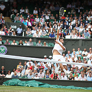 LONDON, ENGLAND - JULY 15: Marcelo Melo of Brazil in action, along with his team mate Lucasz Kubot of Poland, in the Men's Doubles Final on Center Court during the Wimbledon Lawn Tennis Championships at the All England Lawn Tennis and Croquet Club at Wimbledon on July 15, 2017 in London, England. (Photo by Tim Clayton/Corbis via Getty Images)