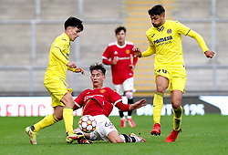 Manchester United's Martin Svidersky (centre) and Villarreal's Rodrigo Alonso Martin (left) battle for the ball during the UEFA Youth League, Group F match at Leigh Sports Village, Manchester. Picture date: Wednesday September 29, 2021.