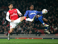 Photo: Tom Dulat/Sportsbeat Images.<br /> <br /> Arsenal v Steaua Bucharest. UEFA Champions League. 12/12/2007.<br /> <br /> Ifeanyi Emeghara of Steaua Bucharest and Denilson of Arsenal fly to et the ball.