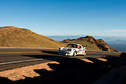 June 26-30 - Pikes Peak Colorado. Christopher Lennon runs his car during practice for the 91st running of the Pikes Peak Hill Climb.