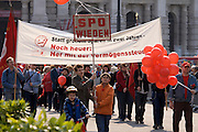 "Maiaufmarsch (Labour Day March) of the SPOE (Social Democratic Party of Austria). Delegations from all of Vienna's districts arriving at the Rathaus (City Hall). Marchers demanding to tax the rich (introduce a ""Vermo?genssteuer"")."