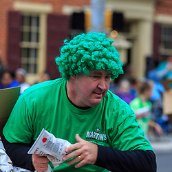 York, PA / USA - March 12, 2016: A man wears a green wig in Irish spirit at the annual Saint Patrick's Day Parade.
