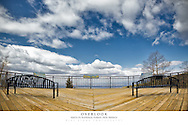 20x30 poster print of two benches with a view of the clouds.