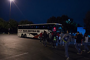 The Iraan High School football team load the busses for the state championship game at AT&T Stadium in Arlington, Texas on December 15, 2016. (Cooper Neill for The New York Times)