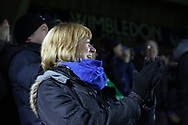 AFC Wimbledon fan celebrating goal during the EFL Sky Bet League 1 match between AFC Wimbledon and Southend United at the Cherry Red Records Stadium, Kingston, England on 24 November 2018.
