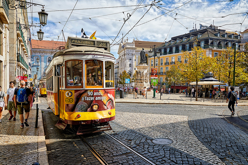 A trolley moves through the streets of Lisbon, Portugal