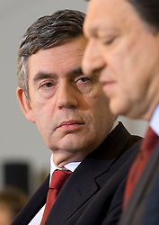 Gordon Brown, U.K.'s prime minister, left, listens during a press conference with Jose Manuel Barroso, European Commission president at the European Commission headquarters in Brussels, Belgium, on Thursday, Feb. 21, 2008. Gordon Brown is on his first official visit to the European Union since becoming prime minister. (Photo © Jock Fistick)