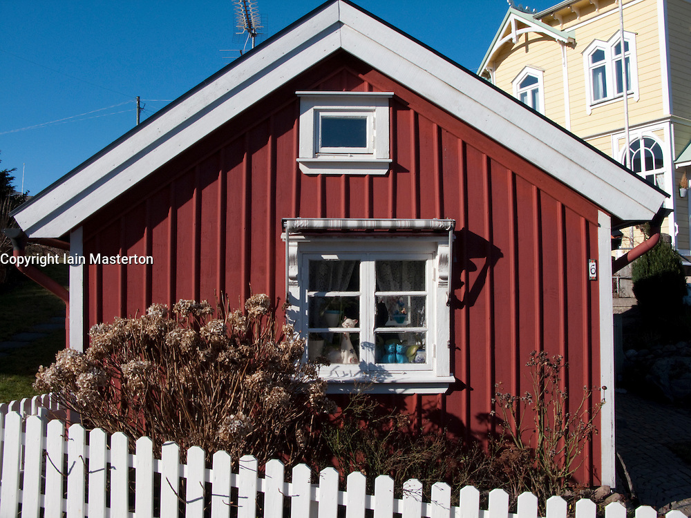 Small wooden cottage in traditional red paint in Lysekil town on Swedens west Bohuslan Coast  2009