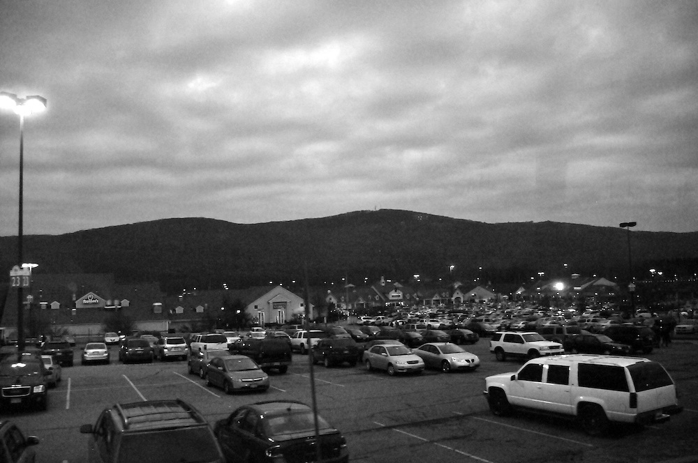 The sky begins to brighten as the sun rises around 6 a.m. on Black Friday Nov. 28 2008.  The parking lot is still mostly full from all who have shopped through the night.