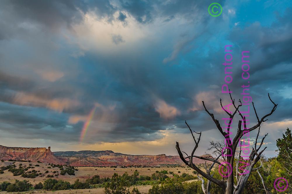 Dramatic sky and rainbow at sunset, Chimney Rock and Ghost Ranch, Chama Basin, New Mexico, © David A. Ponton