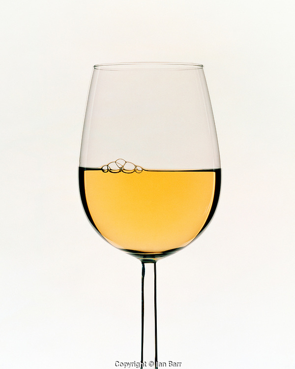 Graphic shot of a glass of white wine on white background,