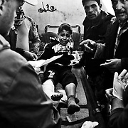 Ahmed Muhammad Fars, 9, of Mosul, is treated at theGogjali field clinic in Iraq after injuries sustained from a mortar attack in Mosul, Iraq.