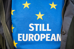 © Licensed to London News Pictures. 13/03/2017. London, UK. A demonstrator wears a t-shirt saying 'still European' in Parliament Square at a protest to demand that the government guarantee the rights of EU citizens living in Britain after Brexit. MPs are set to vote on the Article 50 bill today. Photo credit: Rob Pinney/LNP