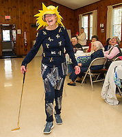 """Hazel Cook begins the Friendship Club's Fashion Show sporting humor in a pair of stylish and comfortable """"baggy"""" pants and a smart """"tee"""" shirt.  Her pretty sunhat completes the outfit as she hits the runway at Leavitt Park on Wednesday afternoon.  (Karen Bobotas/for the Laconia Daily Sun)"""