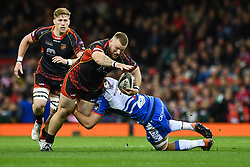 27th April 2019 , Principality Stadium , Cardiff, Wales ; Guinness pro 14's, Round 21, Dragons vs Scarlets ; Lloyd Fairbrother of Dragons is tackled by Josh Macleod of Scarlets<br /> <br /> Credit :  Craig Thomas/Replay Images