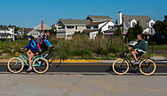 Spring Lake, NJ USA -- May 27, 2017  Bicycle riders are out for a ride on Ocean Avenue the morning of the 5 Mile Race. Editorial Use Only