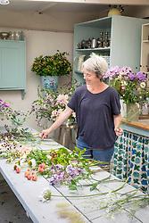 Rachel Siegfried making a hand tied  flower arrangement. Selecting flowers
