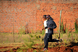 © Licensed to London News Pictures. 02/02/2014. Iten, Kenya. Running in Africa feature. Mo Farah out training. Photo credit : Mike King/LNP