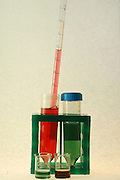 Adding chemicals to test tubes in a tube rack