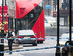 © Licensed to London News Pictures. 14/08/2018. London, UK. A police officer is seen examining a car (back right) which rammed the security barriers at the Houses of Parliament in London. It has been reported that pedestrians were hit by the car. Photo credit: Ben Cawthra/LNP