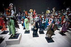 © Licensed to London News Pictures. 25/03/2013. London, UK. Puppets made by artist Geoffrey Farmer are seen at the press view for his exhibition 'The Surgeon and the Photographer' at the Barbican in London today (25/03/2013). The 365 puppets, made by glueing clipped book images to fabric forms, are on display to the public from the 26th of March to the 28th of July 2013. Photo credit: Matt Cetti-Roberts/LNP