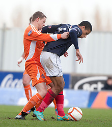 Forfar Athletic's Stephen Tulloch and Falkirk's Lyle Taylor..half time : Falkirk v Forfar Athletic, Scottish Cup fifth round tie, 2/2/2013. .©Michael Schofield.