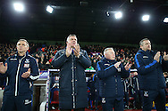 Sam Allardyce, the Crystal Palace manager (2nd left) and his assistants observe a minutes applause before k/o in respect to the recent death of former England manager Graham Taylor.Emirates FA Cup 3rd round replay match, Crystal Palace v Bolton Wanderers at Selhurst Park in London on Tuesday 17th January 2017.<br /> pic by John Patrick Fletcher, Andrew Orchard sports photography.