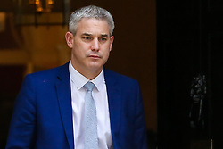 """© Licensed to London News Pictures. 20/03/2019. London, UK. Stephen Barclay- Brexit Secretary departs from No 10 Downing Street. According to No 10 Downing Street, later today British Prime Minister Theresa May will write to European Union chiefs requesting a """"short"""" delay to the date Britain leaves the EU. Photo credit: Dinendra Haria/LNP"""