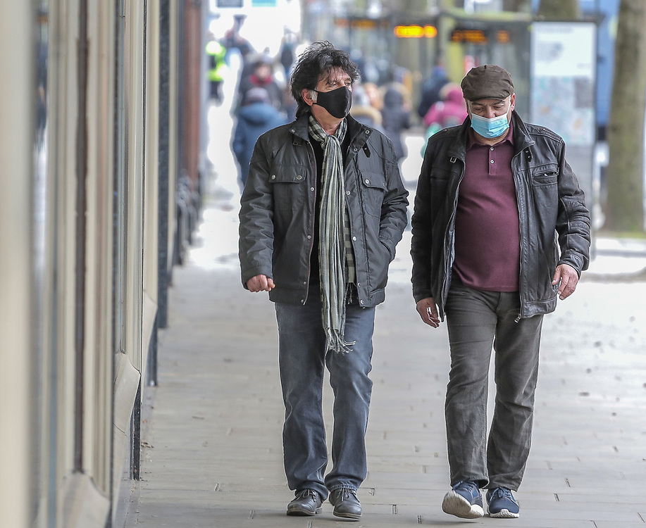 10th March, 2021. Cheltenham, England. Mermbers of the publlic walking through the town centre wearing a mask.
