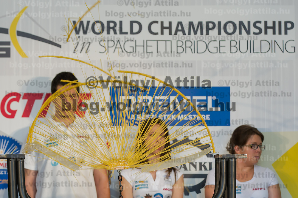 Competitors watch as their construction is being destroyed during the testing at the Spaghetti Bridge World Championship in Budapest, Hungary on May 24, 2013. ATTILA VOLGYI