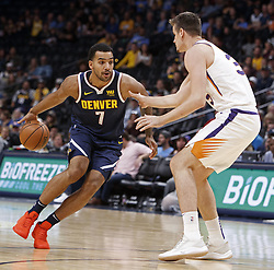 October 20, 2018 - Denver, Colorado, U.S - Nuggets TREY LYLES, left, makes a run to the basket during the 2nd. Half at the Pepsi Center Saturday night. The Nuggets beat the Suns 119-91. (Credit Image: © Hector Acevedo/ZUMA Wire)