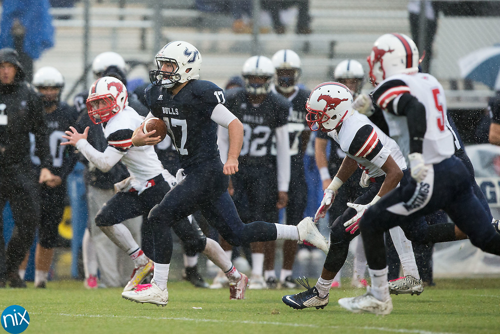 Greg Waslo (17) of the Hickory Ridge Ragin' Bulls breaks away for a 52-yard touchdown run during first quarter action against the East Rowan Mustangs at Hickory Ridge High School on October 2, 2015 in Harrisburg, North Carolina.  The Ragin' Bulls defeated the Mustangs 20-7.  (Brian Westerholt/Special to the Tribune)