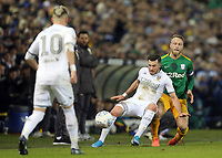 Leeds United's Jack Harrison shields the ball from  Preston North End's Tom Clarke<br /> <br /> Photographer Rich Linley/CameraSport<br /> <br /> The EFL Sky Bet Championship - Leeds United v Preston North End - Thursday 26th December 2019 - Elland Road - Leeds<br /> <br /> World Copyright © 2019 CameraSport. All rights reserved. 43 Linden Ave. Countesthorpe. Leicester. England. LE8 5PG - Tel: +44 (0) 116 277 4147 - admin@camerasport.com - www.camerasport.com