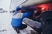 De-icing the bogies of the Canadian during a stopover in Jasper.