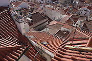 An aerial view overlooking rooftops and TV antennas of the medieval and Moorish district of Alfama, on 13th July 2016, in Lisbon, Portugal. Homes and small businesses have packing narrow streets, stairways and alleyways here since before the earthquake of 1755 which the area largely survived. (Photo by Richard Baker / In Pictures via Getty Images)