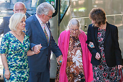 London, June 10th 2014. Veteran entertainer asnd artist Rolf Harris arrives at court with his daughter Bindi, left, his wife Alwen and his niece Jenny, as closing statements are expected in his trial on 12 counts of indecent assault against 4 girls aged 7 to 19.