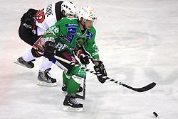 Ales Kranjc vs Pasi Petrilainen at 39th Round of EBEL League ice hockey match between HDD Tilia Olimpija and HK Acroni Jesenice, on December 30, 2008, in Arena Tivoli, Ljubljana, Slovenia. Tilia Olimpija won 4:3. (Photo by Vid Ponikvar / SportIda).