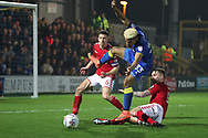 Charlton Athletic defender Patrick Bauer (5) tackling AFC Wimbledon striker Lyle Taylor (33) in the box during the EFL Sky Bet League 1 match between AFC Wimbledon and Charlton Athletic at the Cherry Red Records Stadium, Kingston, England on 10 April 2018. Picture by Matthew Redman.