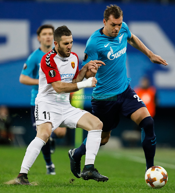 November 23, 2017 - Saint Petersburg, Russia - Artem Dzyuba (R) of FC Zenit Saint Petersburg and Tigran Barseghyan of FK Vardar vie for the ball during the UEFA Europa League Group L match between FC Zenit St. Petersburg and FK Vardar at Saint Petersburg Stadium on November 23, 2017 in Saint Petersburg, Russia. (Credit Image: © Mike Kireev/NurPhoto via ZUMA Press)