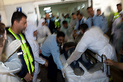 © under license to London News Pictures. 19/02/2011. Injured protesters arrive at Salmaniya Hospital Complex after being fired upon by police during a march to Pearl Roundabout in Manama, Bahrain today (19/02/2011). Photo credit should read Michael Graae/London News Pictures