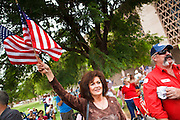 22 OCTOBER 2010 - PHOENIX, AZ:  The crowd at a Tea Party rally in Phoenix, AZ, Friday. About 300 people attended a Tea Party rally on the lawn of the Arizona State Capitol in Phoenix Friday. They demanded lower taxes, less government spending, repeal of the health care reform bill, and strengthening of the US side of the US - Mexican border. They listened to Arizona politicians and applauded wildly when former Alaska Governor Sarah Palin and her son, Trig, made a surprise appearance. The event was a part of the Tea Party Express bus tour that is crossing the United States.     Photo by Jack Kurtz