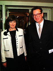 LORD & LADY SAATCHI at a lunch in London on 15th October 1999.<br /> MXW 49