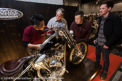 Harley-Davidson's head of design Ray Drea and designers Dais Nagao and Ben McGinley with the recipient of the Harley-Davidson award at the Annual Mooneyes Yokohama Hot Rod and Custom Show. Japan. Sunday, December 7, 2014. Photograph ©2014 Michael Lichter.