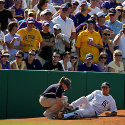 06 June 2009: Rice third baseman Anthony Rendon (center) is tended to by a trainer after suffering a leg injury in the top of the second inning, during game two of the NCAA baseball Super Regional between the Rice Owls and the LSU Tigers at Alex Box Stadium in Baton Rouge, Louisiana.